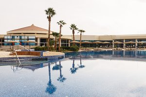 View of the pool, palm trees and res