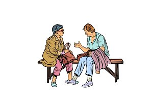 two elderly women sitting on a bench