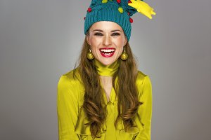 smiling woman in funny Christmas hat