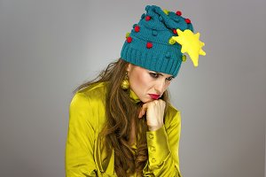 stressed woman in Christmas hat isol