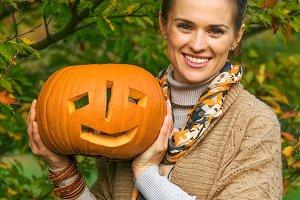 smiling woman showing Halloween pump