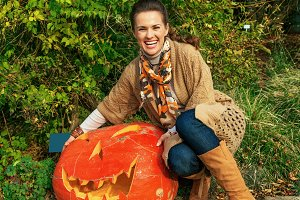 woman showing huge Halloween pumpkin