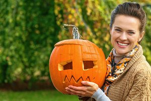 woman showing Halloween pumpkin Jack