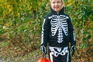 child holding Halloween pumpkin Jack