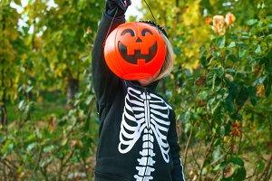 child showing Halloween pumpkin Jack
