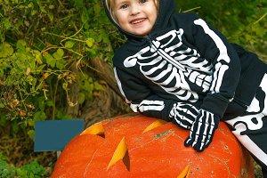 smiling girl with huge Halloween pum