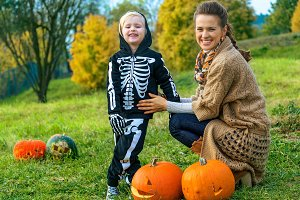 mother and child among Halloween pum