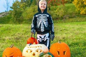 girl among Halloween pumpkins Jack O