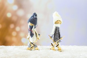 Two decorative skiers dolls skying