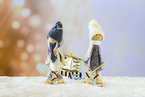 Skiers dragging a sleigh