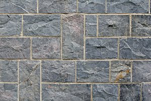 Grey tiled stone wall