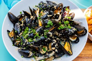 Top view of mussels with curry sauce