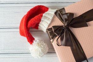 gift box in a cap of Santa Claus
