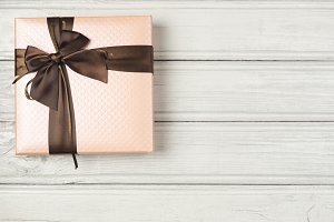 gift box on wooden white background