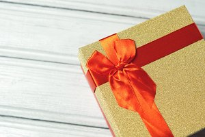 gift box red with gold sequins on wo
