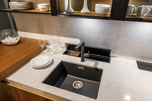 Stylish kitchen with tableware and s