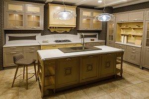 Interior of modern kitchen with beig