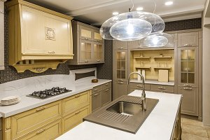 Stylish kitchen with chandelier over