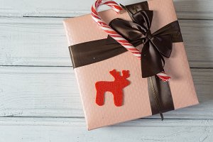Christmas gift box with a red Lollip