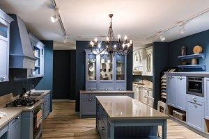 Interior of modern kitchen in blue t