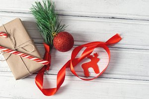 candy cane and gift box on wooden wh