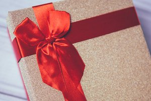 red bow on gift closeup