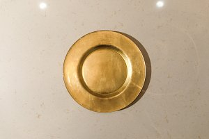 Golden metal plate on light table