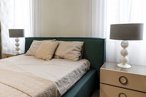 Large bed by window in modern bedroo