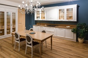 Table with chairs in stylish kitchen