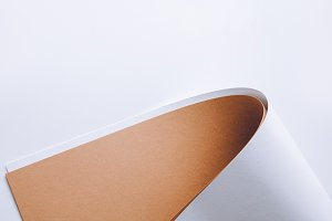 white and brown rolled paper sheets