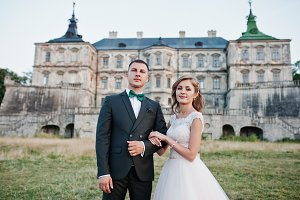 Fabulous wedding couple posing in fr