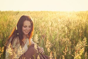 Beautiful girl in a field