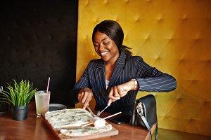 African american businesswoman eatin