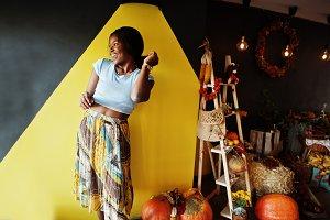 African american girl against autumn