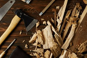 axe, chisel, handsaw and wooden piec