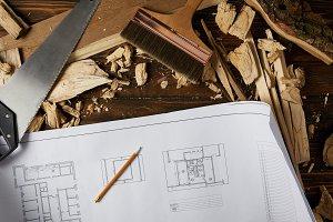 top view of blueprint, pencil, paint