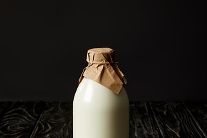 fresh milk in bottle wrapped by pape