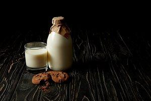 chocolate cookies, fresh milk in gla
