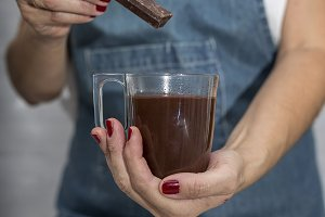 Woman's hands with chocolate cup
