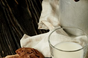 chocolate cookies, milk in glass and
