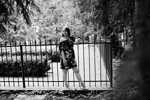 Portrait of a girl in a dress posing