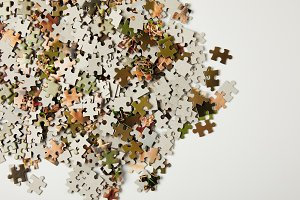 top view of jigsaw puzzle pieces wit