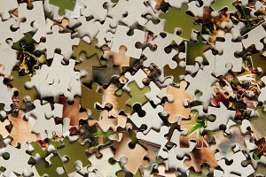 top view of jigsaw puzzle pieces bac