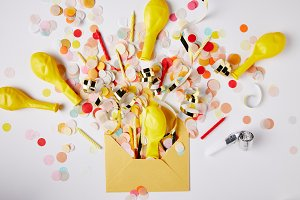 top view of confetti pieces, balloon