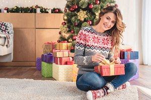 attractive woman in sweater preparin