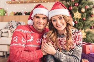 smiling husband and wife in santa ha