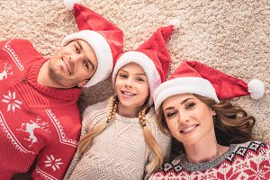 elevated view of smiling parents and