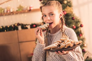 happy kid eating traditional christm