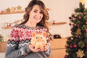 beautiful smiling woman holding pigg
