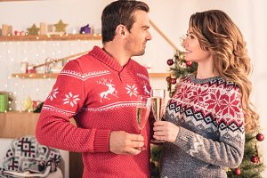 smiling couple in christmas sweaters